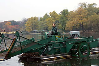 Adam on the Weed Harvester